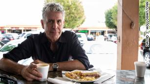 160914120051-bourdain-looking-at-camera-with-plate-of-food-medium-plus-169