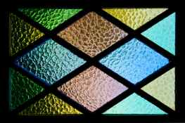 green yellow brown and blue stained glass